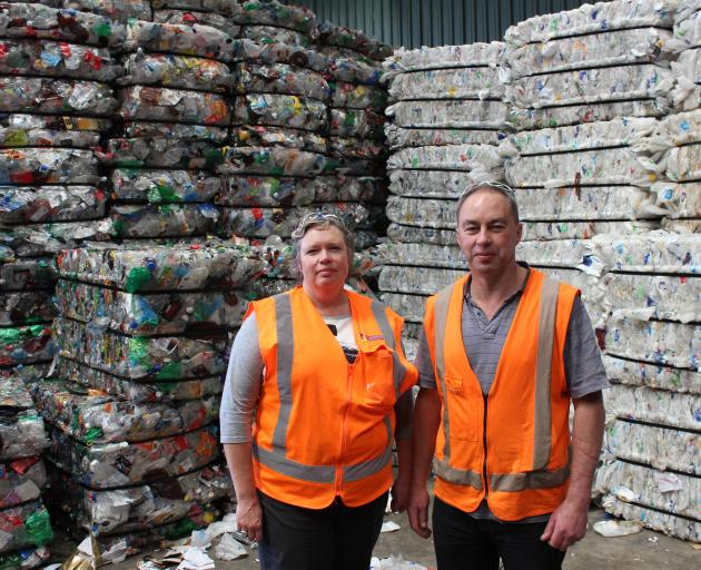 Catherine Gledhill and Jeff Gamble at the recycling plant in Green Island, with baled plastics processed to be recycled and re-used. PHOTO: ELLA STOKES