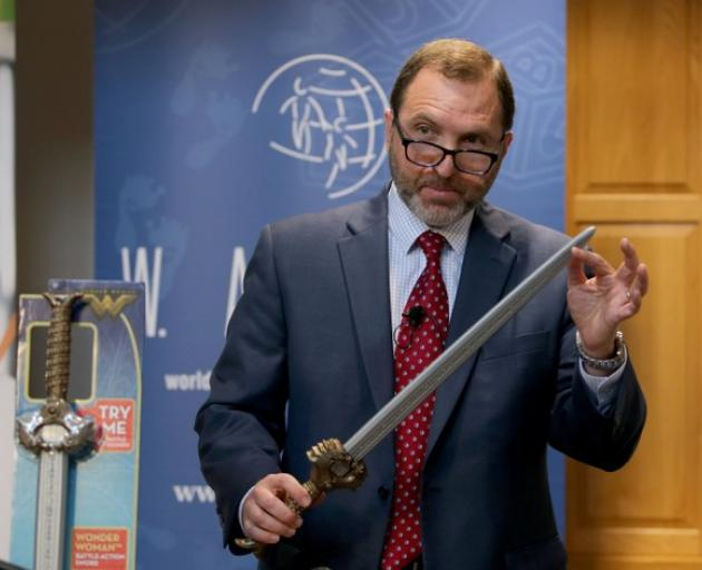 Attorney James A. Swartz holds the Wonder Woman Battle-Action Sword as he talks during the Watch news conference. Photo: Reuters