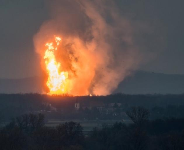 A column of fire is seen after an explosion ripped through Austria's main gas pipeline hub in Baumgarten. Photo: Reuters