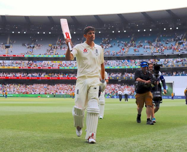 England's Alastair Cook reacts as he walks off the ground at the end of the third day of the...