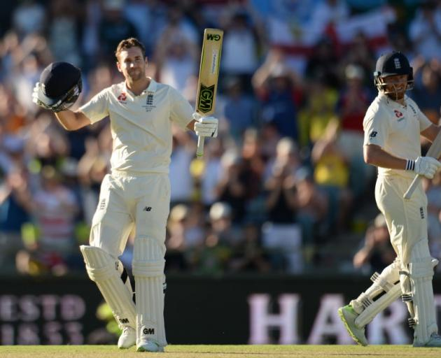 Dawid Malan celebrates his century on day one of the third Ashes test in Perth yesterday. Photo:...