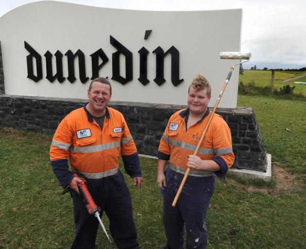 Nick Poole (left) and Michael Cotter, of Moran Fabrication, complete work on the Dunedin city boundary sign, near Allanton yesterday. Photo: Christine O'Connor