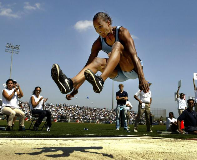 American  Marion Jones leaps 7.13m to win the long jump at the track and field invitational in...
