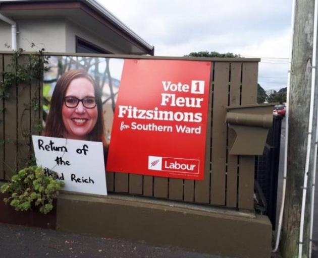 The sign left on Fleur Fitzsimons' fence has been widely condemned. Photo:Twitter