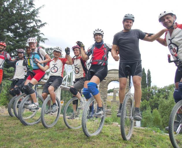 Unicyclists (from left) Nicola Cassanelli, of Italy, Tomas Nemecek, of Arizona, Jaco Wood, of...