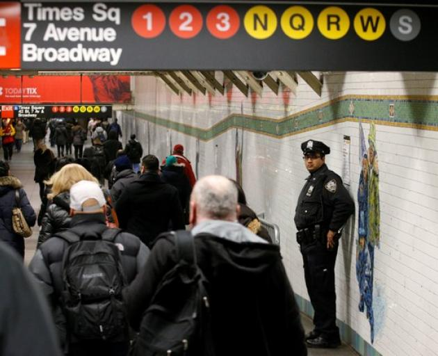 New Yorkers will see an increased police presence around mass transit and places where people gather on New Year's Eve. Photo: Reuters