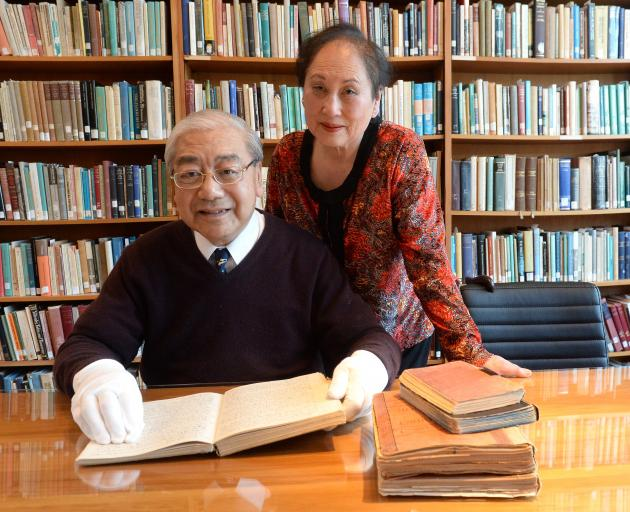 Historian Dr Jim Ng and his wife Eva looks at adiary from the Ng New Zealand Chinese Collection at Knox College, in Dunedin, yesterday. PHOTO: LINDA ROBERTSON