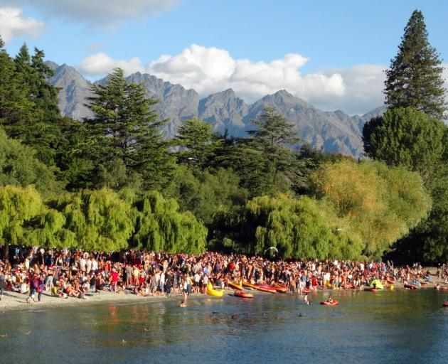 Hundreds of people gathered on the beach at Queenstown Bay on Christmas Day. Photo: Louise Scott
