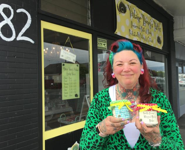 Vintage Honey's Parlour owner Nicola Chisholm displays her homemade body butters outside her shop in St Kilda. PHOTO: SHAWN MCAVINUE