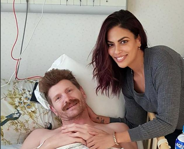 Adam Thomson pictured with partner Jessie Gurunathan in the Tsukuba Memorial Hospital in Tokyo. Photo: Instagram