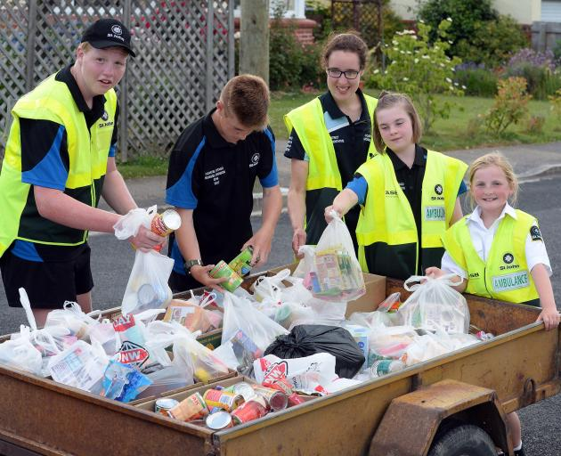 Collecting donated items during  the Mosgiel foodbank drive are (from left) Miciah Nicholl (15),...
