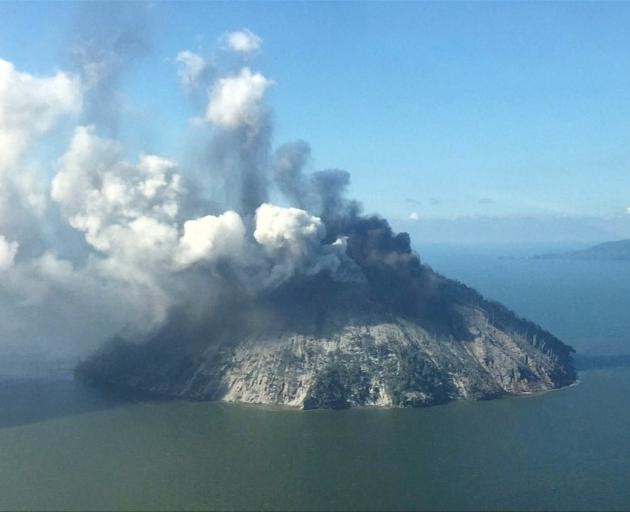The remote island volcano of Kadovar spews ash into the sky in Papua New Guinea. Photo: Reuters...
