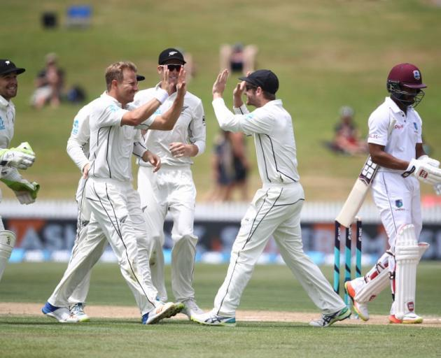 7d717b95528 Neil Wagner celebrates taking a wicket with his Black Caps team mates  against the West Indies