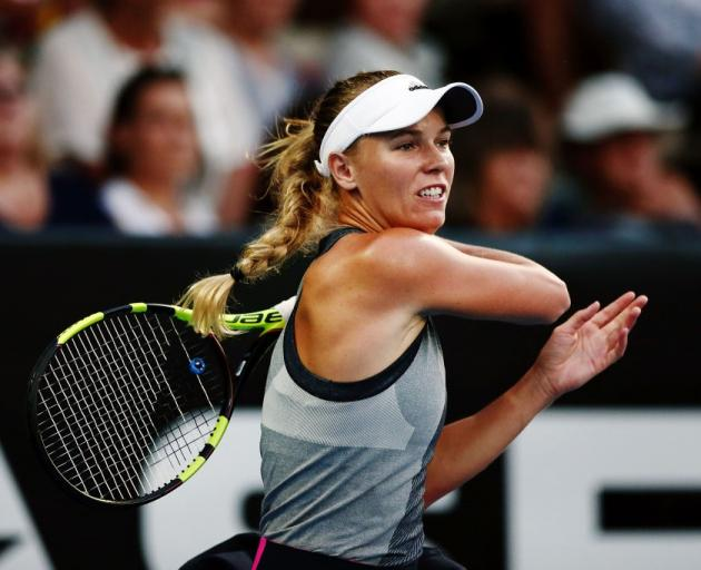 Caroline Wozniacki plays a shot during her opening ASB Classic match yesterday. Photo: Getty Images