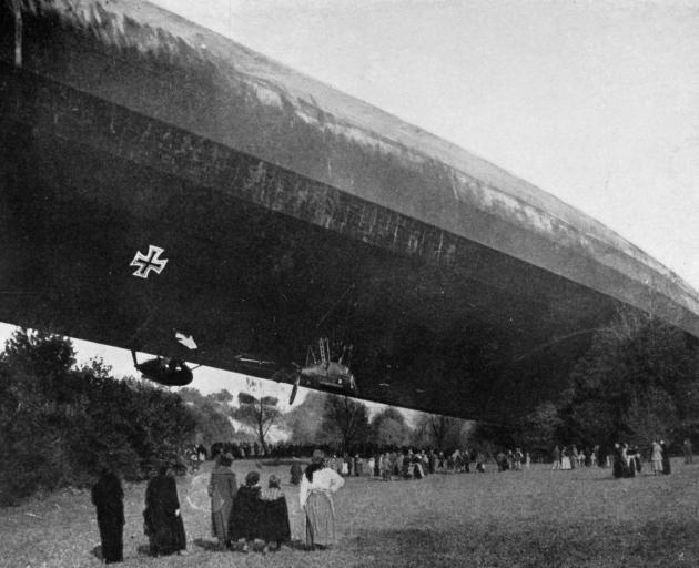 The fate of a bomb-dropping Zeppelin: the L49 stretched across the tree-tops at Bourbonne-les-Bains. - Otago Witness, 2.1.1918.