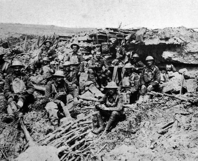 British guardsmen outside a smashed German machine-gun emplacement. - Otago Witness, 2.1.1918.