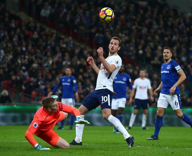 A familiar sight: Tottenham Hotspurs' Harry Kane guides the ball past Everton's Jordan Pickford...