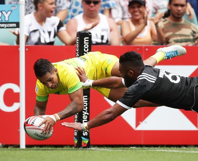 Maurice Longbottom of Australia beats Vilimoni Kordi of New Zealand to score in the corner in the...