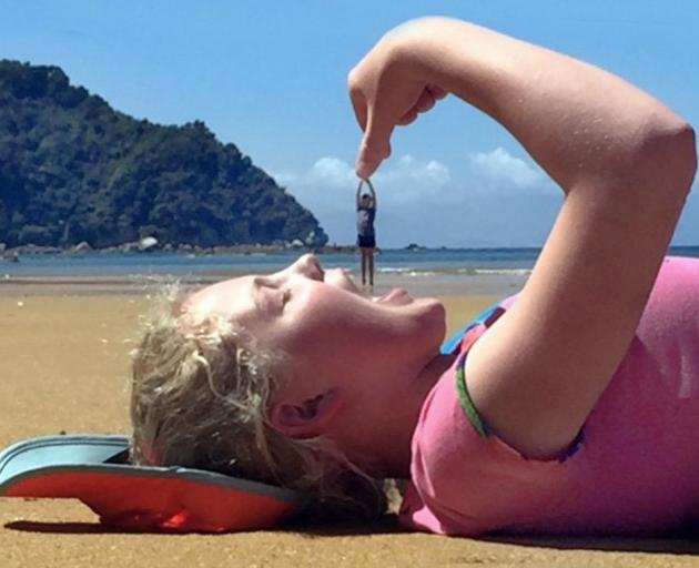 The winning photo of Hannah  eating Josie O'Neill at Abel Tasman Park earlier this month.