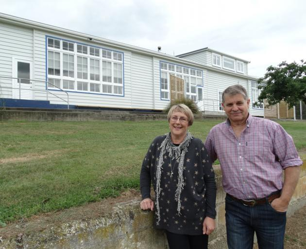 Craig and Blanche Sturgess outside their Enfield property, formerly Enfield School. Photo: Daniel Birchfield