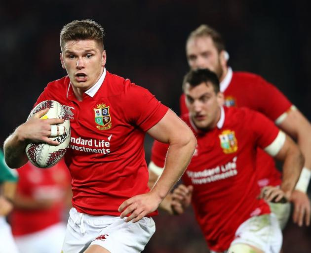 Owen Farrell runs the ball for the British and Irish Lions in New Zealand last year. Photo: Getty...