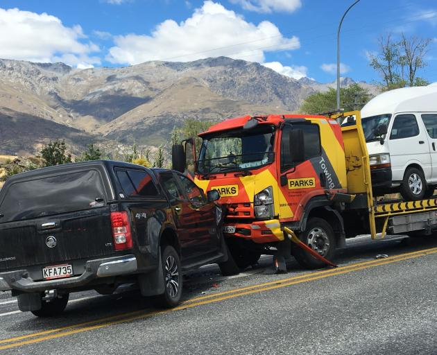 Glen Collins' tow truck was thrown into a stationary Holden Colorado after a tourist driver pulled out in front of him at Arrow Junction near Queenstown yesterday. Photo: Meena Amso