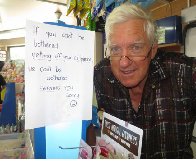 Dairy owner Mark Douglas warns off would be cellphone users at his Queenstown dairy. Photo:...
