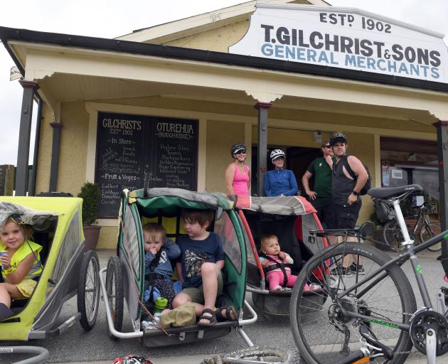Having a breather outside Gilchrist's General Store in Oturehua are, from left (front), Brianna Field, Grace Murray, Archie Murray and Sophie Field, (rear) Jodi Field, Heather Peart, Jacob Murray and Mike Field. The Fields from Auckland and the Pearts fro