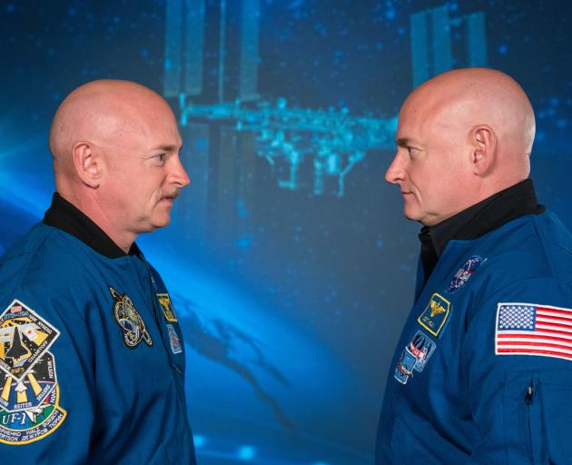 Astronauts Scott Kelly (right) and his twin Mark at a media conference following Scott's 12 month...