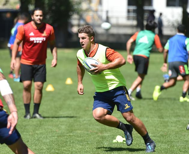Highlanders midfielder Tei Walden runs with the ball at training at Logan Park yesterday while Tyrel Lomax (left) and Matt Faddes look on. Photo: Gregor Richardson
