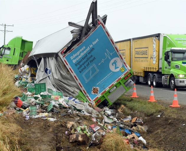 A Summerland Express Freight truck lost its load of groceries after crashing on State Highway 1 near Palmerston yesterday. Photo: Stephen Jaquiery