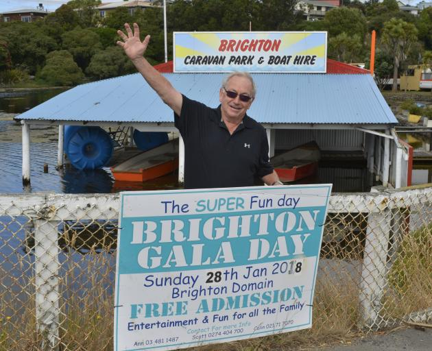 Colin Weatherall hangs up signs ahead of the Brighton Gala Day. Photo: Gerard O'Brien