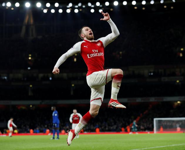 Arsenal's Aaron Ramsey celebrates scoring their fifth goal to complete his hat-trick. Photo: Reuters