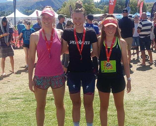 Cecilia Crooks (17), Ella Harris (19) and Georgia Mitchell (17) after winning the Challenge Wanaka half women's teams race last weekend. Photo: Supplied