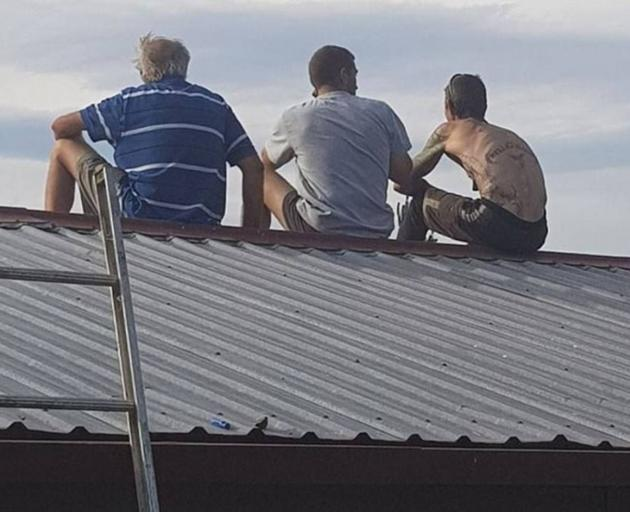 Emalee Millar took this photo of her father and his boss and workmate, as they watched the Burnside blaze yesterday afternoon. Photo / Facebook