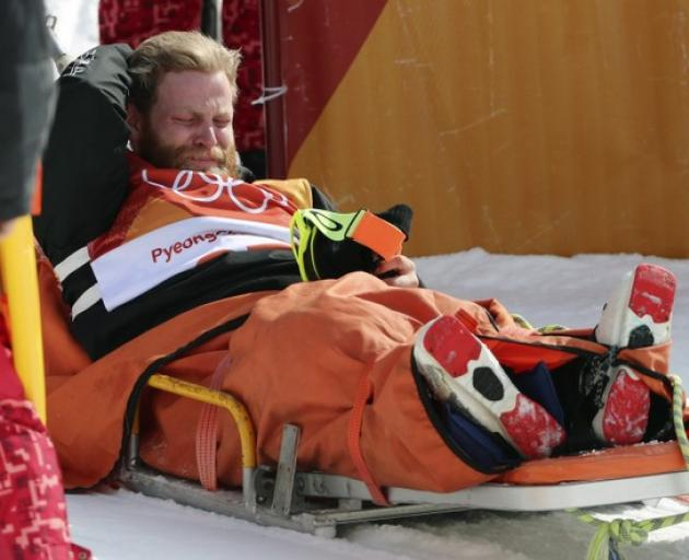 Byron Wells reacts after injuring himself before the men's ski halfpipe final at the Winter Olympics. Photo: Reuters