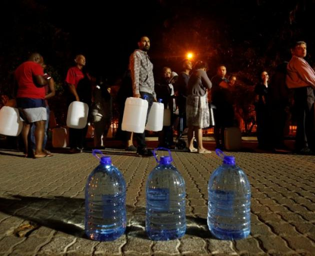 People queue to collect water as fears over the city's water crisis grow in Cape Town. Photo: Reuters