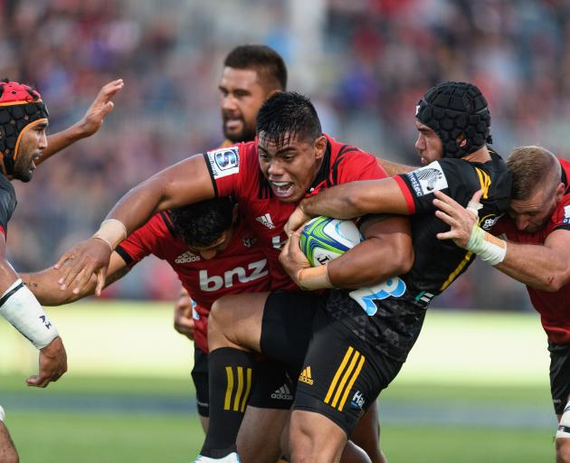 Michael Alaalatoa of the Crusaders is tackled by Charlie Ngatai of the Chiefs. Photo: Getty Images