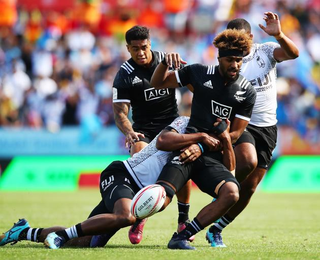 Luke Masirewa of New Zealand drops the ball against Fiji in the semi final during the 2018 New...
