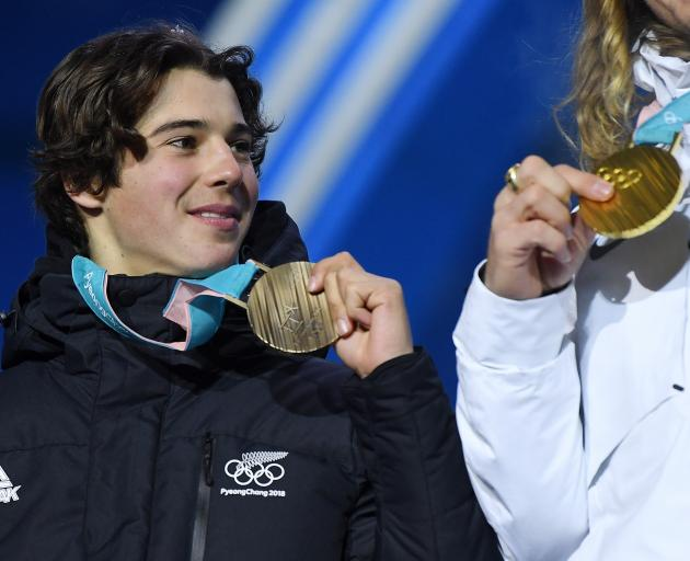 Nico Porteous eyes up the gold while showing off his bronze medal from the Winter Games in South...