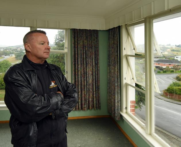 Landlord Mark Cowan stands in his Balclutha rental property, which has tested positive for...