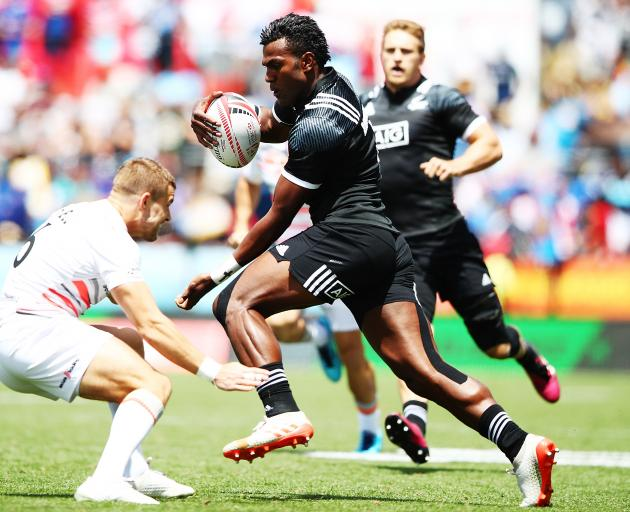 Joe Ravouvou of New Zealand makes a break against England during the 2018 New Zealand Sevens. Photo: Getty Images