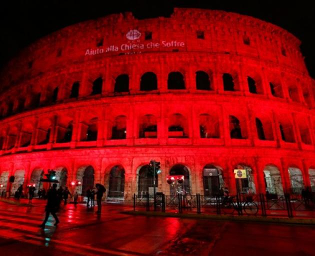 The Colosseum is lit up in red to draw attention to the persecution of Christians around the world in Rome. Photo: Reuters