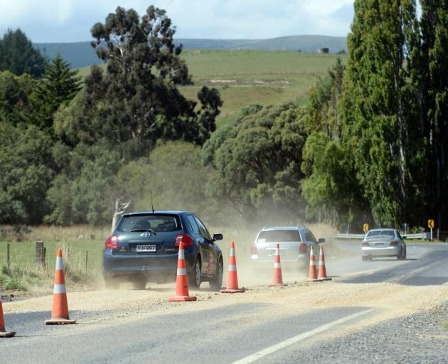 Gravel patches temporarily fill holes in Factory Rd, Mosgiel. Photo: Linda Robertson