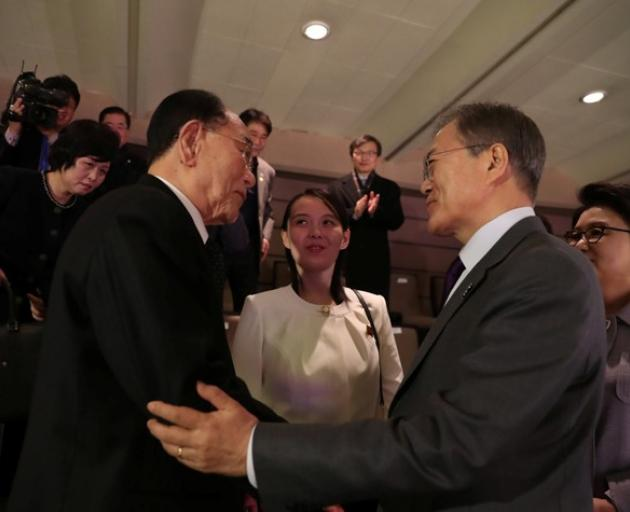 South Korean President Moon Jae-in talks with president of the Presidium of the Supreme People's Assembly of North Korea Kim Young Nam. Photo:  Yonhap via Reuters