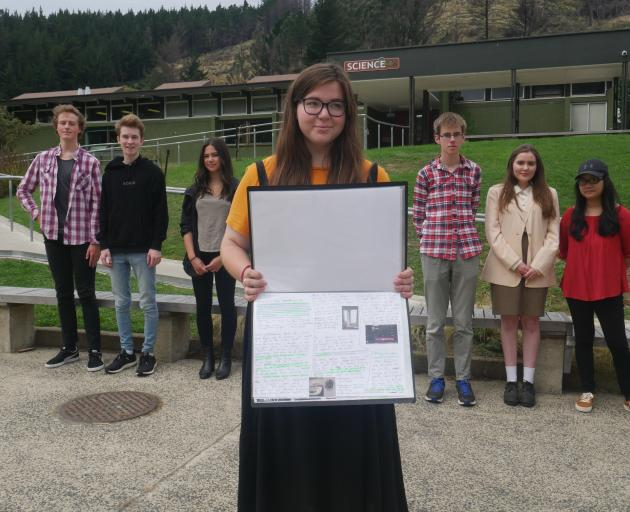 Former Logan Park High School pupil Isla Thomas (18) shows off the photography workbook she completed as part of the photography scholarship requirements. Also pictured are scholarship recipients (from left) Sean McLeod, Oscar McGuire, Siobhan Quinn, Loui