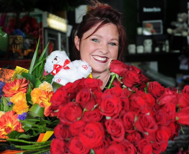Dunedin florist Donna Hewer with red roses and a colourful bouquet for Valentine's Day. Photo: Christine O'Connor