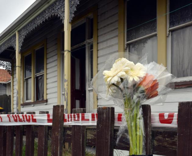 A bouquet of flowers is placed outside a Wesley St property after a fatal fire in Dunedin. Photo:...