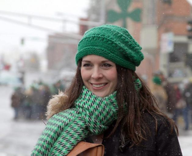 A parade-goes wraps up in green to ward off the cold on Park St. Photo: Gwyneth Hyndman
