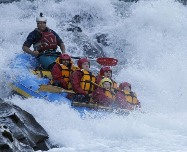 Keith 'Chief' Haare, pictured at the back of the raft, on the rapids. Photo: supplied